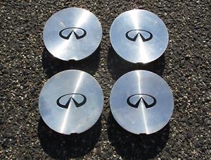 Genuine 1995 to 1998 Infiniti I30 Q45 alloy wheel center caps hubcaps