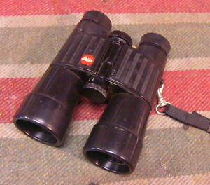 Leitz (leica) trinovid binoculars Works OK cond with an issue.