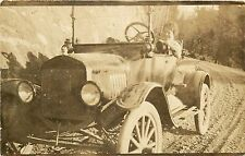 c1920 RPPC Postcard Smiling Woman Drives Open Car on Mountain Road Unknown US