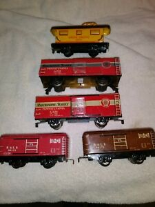 5 Marx Model trains o scale 2 B & LE red and brown Penn long boxcar 2 variations
