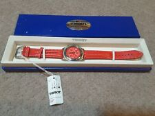 New Tissot mens water resistant chronograph watch in box.. Red leather strap .