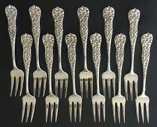"""12 RARE STERLING SILVER DESSERT FORKS """"FLORAL REPOUSS'E"""" by J. E. CALDWELL & CO"""