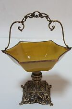 Collectibles porcelain bowl with brass in yellow color