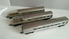 "Triang : 3 x Silver Coaches ""00"" Gauge."