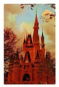 Postcard Disney World Glowing warmly at twilight, Cinderella Castle Fantasyland.
