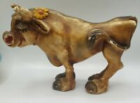 """Vintage Chalkware Brown Bull / Cow with Flower 10"""" Long 6.5"""" High"""