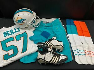 #57 TREVOR REILLY MIAMI DOLPHINS GAME USED HELMET JERSEY PANTS W/CLEATS & SOCKS