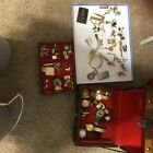 Vintage+men%E2%80%99s+jewelry+box+filled+with+watches+tie+clips+and+pins+etc.