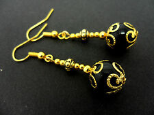 A PAIR OF DANGLY BLACK ONYX BEAD  GOLD PLATED DROP EARRINGS.