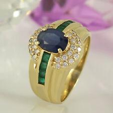 Ring in 585 Gelbgold 14K mit 1 Saphir, 8 Smaragden + 28 Diamanten Gr. 56