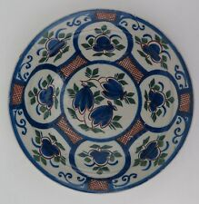 London delftware plate with blue flowers and red hatched ground c1720