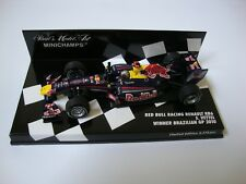 1:43 MINICHAMPS VETTEL REDBULL BRAZILIAN GP WINNER W CHAMPION 2010