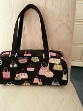 Black purse with purses on it.  It also comes with a shoulder strap.