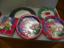 Lot of Still sealed 4 packages of Christmas paper plates, 1 package of napkins