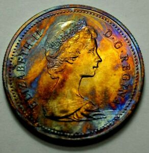 1980 CANADA DOLLAR $1 CANOE VOYAGEUR ELIZABETH II COIN, TONED, No Reserve..