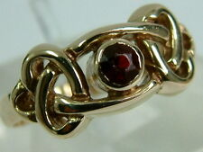 SWEET 9CT YELLOW GOLD LADIES RING - CELTIC KNOT WITH SINGLE GARNET