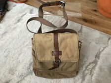 FOSSIL CANVAS AND FAUX LEATHER CROSS BODY BAG....