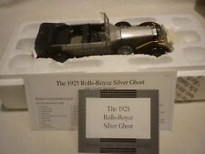A Franklin mint scale model car of a 1925 Rolls Royce Silver Ghost, boxed