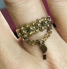 Beautiful ring gold on silver with two small chains heart & key