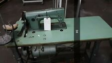 CONSEW MODEL 99, SIT-DOWN MACHINE WITH TABLE AND MOTOR