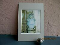 vintage Beatrix Potter of little pig, Pigwig  in a chair
