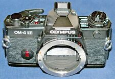 OLYMPUS OM-4Ti 35mm SLR Body [Black] with shoulder/neck strap