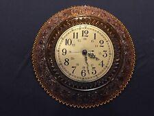 Tiara wall clock in amber color