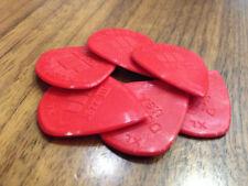 Pièces et accessoires rouge Dunlop pour guitare et basse