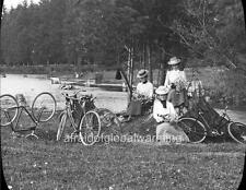 Old Photo. Pacific Northwest. Women With Bicycles Holding Flowers