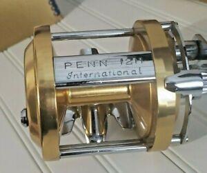 Penn International gold anodized model 12H Ex w/ Ex box, bag, catalog, tool etc.