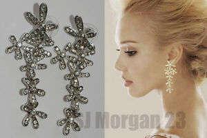 Pair Of Rhinestone Chrystal Drop Flower Design Bridal Earrings .Silver or Gold.