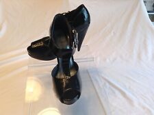 Wild Rose ladies black synthetic patent leather t-strap shoes in size 6.5 medium