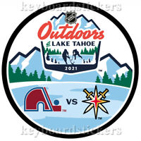 2021 NHL Outdoors Dueling Hockey Puck Colorado Avalanche vs Vegas Golden Knights