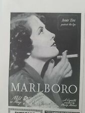 1938 Marlboro cigarettes Ivory tips protect lips woman smoking ad