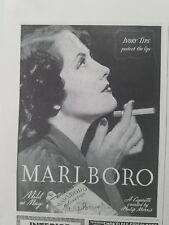 1938 Marlboro cigarettes Ivory tips protect lips woman smoking ad