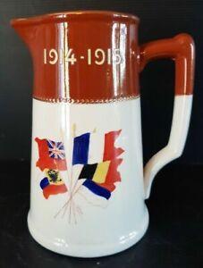 PICHET COMMÉMORATIF 1914-1915 EN CÉRAMIQUE ÉMAILLÉE