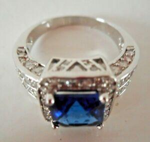 14KT White Gold Dress Ring + Large Blue Stone & small white stones Size P