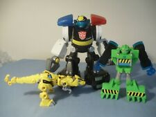LOT OF 3 TOY TRANSFORMERS GREEN RESCUE BOT & HASBRO YELLOW DINOSAUR & POLICE BOT