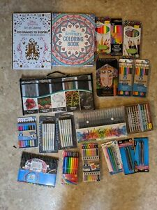 Lot of markers colored pencils brush pens and more plus two coloring books