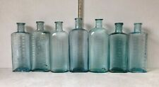 SEVEN NICE OLD AQUA GLASS TABLE-SPOONS MEASURING BOTTLES.
