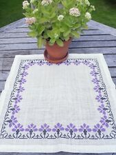 White cotton tablecloth with embroidered purple flowers
