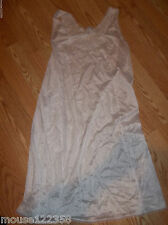 white slip no tags measures appr 42 inches lace trim