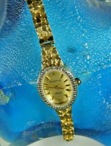 Beautiful 14K Gold watch w/14K Tapering Nugget band, Oval Diamond Bezel 0.16 TCW