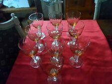 Dix verres en cristal de couleur orange estampillés SL (Saint Louis).