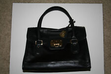 Cole Haan handbag and key chain. Very good condition  clean inside and out.