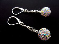 A PAIR OF DANGLY WHITE SHAMBALLA STYLE LEVERBACK HOOK EARRINGS.