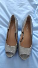 Pair of ladies high heeled shoes from Fiore. Wide fit UK size 5 Euro 38 Silver.