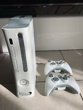 Xbox 360 with 2 controllers and 8 games