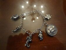 VINTAGE STERLING SILVER CHARM BRACELET WITH 6 OLD STERLING SILVER DISNEY CHARMS
