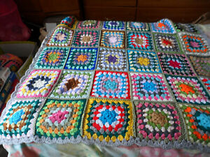 new Crochet blanket. hand made. very colourful. size is 43x43 ins square.